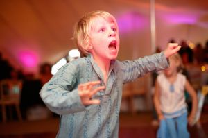 A photograph of a young guest enjoying the reception
