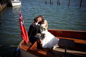 The happy couple sailing away